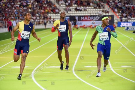 Jamaican sprinter Asafa Powell (C) reacts as he injures his leg during 100m race final between French Jimmy Vicaut (L) and US Mike Rodgers (R) during Meeting Madrid 2019 athletics event at Vallehermoso Stadium, in Madrid, Spain, 25 August 2019 (issued on 26 August 2019).