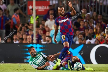 FC Barcelona's midfielder Rafinha (R) and Betis' midfielder Nabil Fekir (L) in action during the Spanish LaLiga match between FC Barcelona and Real Betis at Camp Nou stadium in Barcelona, Catalonia, Spain, 25 August 2019.