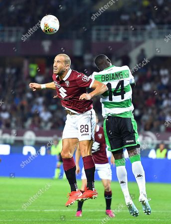 Torino's Lorenzo De Silvestri (L) in action against Sassuolo's Pedro Obiang (R) during the Italian Serie A soccer match between Torino FC and US Sassuolo Calcio in Turin, Italy, 25 August 2019.