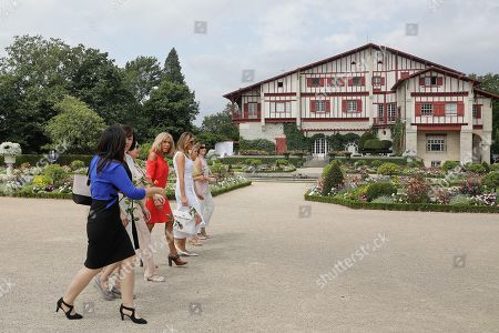 Brigitte Macron, wife of French President, US First Lady Melania Trump, Akie Abe, wife of Japan's Prime Minister, Chile's First Lady Cecilia Morel, Jenny Morrison, wife of Australia's Prime Minister, and Malgorzata Tusk, wife of European Council President walk in the garden of the Villa Arnaga, House-museum of Edmond Rostand, during a visit on traditional Basque culture in Combo-les-Bains, near Biarritz