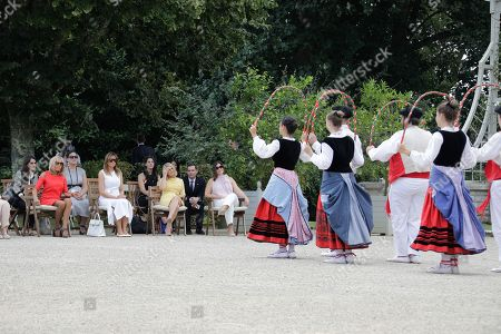 Brigitte Macron, wife of French President, US First Lady Melania Trump, Akie Abe, wife of Japan's Prime Minister, Chile's First Lady Cecilia Morel, Jenny Morrison, wife of Australia's Prime Minister, Malgorzata Tusk, wife of European Council President and Adele Malpass, wife of World Bank President look at Basque dancers in the garden of the Villa Arnaga, House-museum of Edmond Rostand, during a visit on traditional Basque culture in Combo-les-Bains, near Biarritz