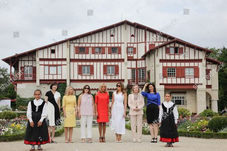 Brigitte Macron, wife of French President, US First Lady Melania Trump, Akie Abe, wife of Japan's Prime Minister, Chile's First Lady Cecilia Morel, Jenny Morrison, wife of Australia's Prime Minister, Malgorzata Tusk, wife of European Council President and Adele Malpass, wife of World Bank President in the garden of the Villa Arnaga, House-museum of Edmond Rostand, during a visit on traditional Basque culture in Combo-les-Bains, near Biarritz