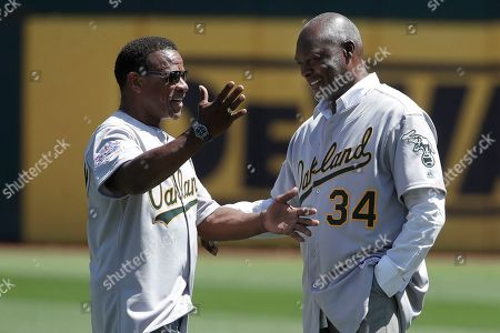 Rickey Henderson, Dave Stewart. Former Oakland Athletics player Rickey Henderson, left, gestures next to former teammate Dave Stewart before a baseball game between the Athletics and the San Francisco Giants in Oakland, Calif