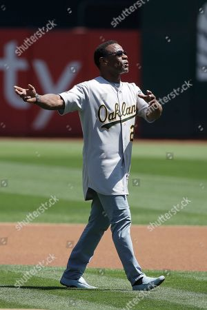 Former Oakland Athletics player Rickey Henderson is introduced before a baseball game between the Athletics and the San Francisco Giants in Oakland, Calif