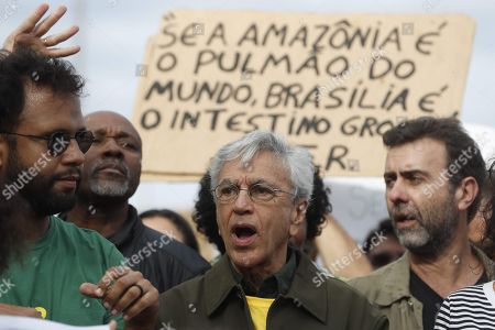 Brazilian singer Caetano Veloso (C) takes part in a march along with thousands of persons for the conservation of the Amazon rainforest and against the Brazilian President Jair Bolsonaro, at the Ipanema beach in Rio de Janeiro, Brazil, 25 August 2019. Thousands of soldiers have reinforced the firefighting operation in the Amazon, where the number of states that have asked Federal Government aid has increased to seven.