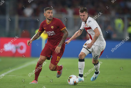 Aleksandar Kolarov of AS Roma and Lukas Lerager of Genoa