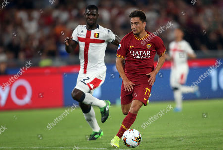Cengiz Under of AS Roma and Cristian Zapata of Genoa in action