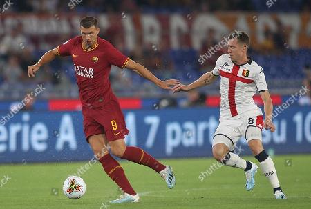 Edin Dzeko of AS Roma and Lukas Lerager of Genoa