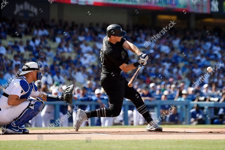 DJ LeMahieu, Austin Barnes. New York Yankees' DJ LeMahieu, right, hits a solo home run as Los Angeles Dodgers catcher Austin Barnes watches during the first inning of a baseball game, in Los Angeles
