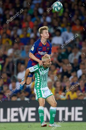 Frenkie de Jong of Barcelona and Sergio Canales of Real Betis
