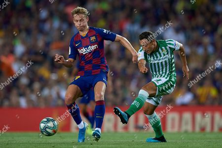 Frenkie de Jong of Barcelona and Andres Guardado of Real Betis