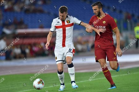 Lukas Lerager of Genoa and Bryan Cristante of AS Roma