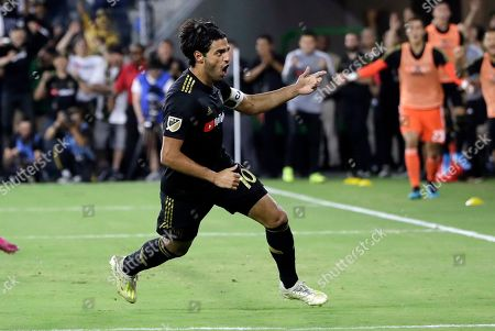 Los Angeles FC's Carlos Vela (10) celebrates after scoring against the Los Angeles Galaxy during the second half of an MLS soccer match, in Los Angeles