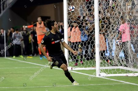 Los Angeles FC's Carlos Vela celebrates after scoring against the Los Angeles Galaxy during the second half of an MLS soccer match, in Los Angeles