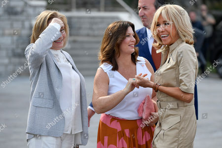 Stock Image of French first lady Brigitte Macron (R) greets Jenny Morrison (C), wife of Australia's Prime Minister Scott Morrison and Chile's First Lady Cecilia Morel (L) upon their arrival by the Cote des Basques beach as part of the G7 summit, in Biarritz, France, 26 August 2019. The G7 Summit runs from 24 to 26 August in Biarritz.
