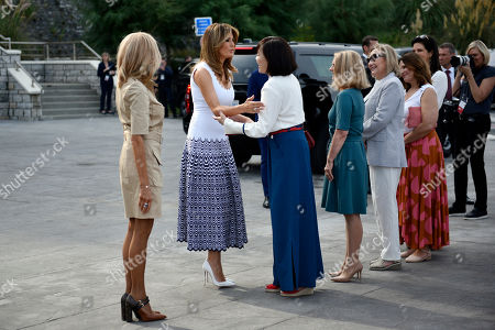 Stock Picture of From L-R Brigitte Macron, wife of French President Emmanuel Macron, U.S. First Lady Melania Trump, Akie Abe, wife of Japan's Prime Minister Shinzo Abe, Chile's First Lady Cecilia Morel, Jenny Morrison, wife of Australia's Prime Minister Scott Morrison, Malgorzata Tusk, wife of European Council President Donald Tusk and Adele Malpass, wife of World Bank President David Malpass arrive by the Cote des Basques beach as part of the G7 summit in Biarritz, France, 26 August 2019. The G7 Summit runs from 24 to 26 August in Biarritz.