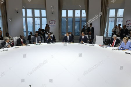 The empty chair of US Presisdent Donald Trump is seen as (from L) leader UN general secretary Antonio Guterres, South african president Cyril Ramaphosa, Burkina president Roch Marc Christian Kabore, Rwanda president Paul Kagame, French President Emmanuel Macron and Egyptian President and Chairman of the African Union Abdel Fattah al-Sissi, Chile president Sebastian Piniera and German chancellor Angela Merkel attend a work session focused on climate in Biarritz, south-west France on August 26, 2019, on the third and last day of the annual G7 Summit attended by the leaders of the world's seven richest democracies, Britain, Canada, France, Germany, Italy, Japan and the United States.