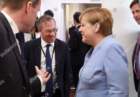 Stock Picture of Angela Merkel (R) Chancellor of Germany with  British Ambassador to France Ed Llewellyn (2-L) during the G7 summit in Biarritz, France, 26 August 2019. The G7 Summit runs from 24 to 26 August in Biarritz.