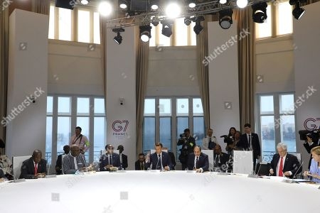 (L-R) South African President Cyril Ramaphosa, Burkina Faso's President Roch Marc Christian Kabore, Rwanda's President Paul Kagame, French President Emmanuel Macron, Egyptian President and Chairman of the African Union Abdel Fattah al-Sissi, Chile's President Sebastian Pinera and German Chancellor Angela Merkel attend a work session focused on climate in Biarritz, south-west France, 26 August 2019. The G7 Summit runs from 24 to 26 August in Biarritz.