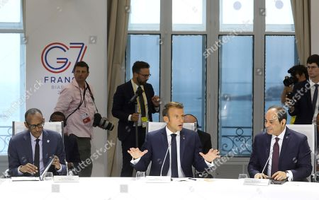 (L-R) Rwanda's President Paul Kagame, French President Emmanuel Macron and Egyptian President and Chairman of the African Union Abdel Fattah al-Sissi attend a work session focused on climate in Biarritz, south-west France, 26 August 2019. The G7 Summit runs from 24 to 26 August in Biarritz.