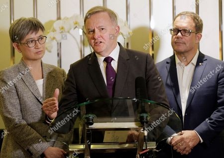 Australia's opposition leader Anthony Albanese, center, speaks to the media as Labor Party's Foreign Affairs Spokeswoman Penny Wong, left, and Chair of Regional Trade Taskforce Luke Gosling, right, look, during a press conference in Jakarta, Indonesia