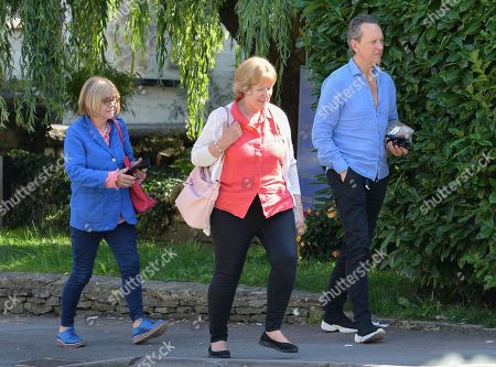 Stock Image of Richard E Grant and friend with his wife Joan Washington (in blue)
