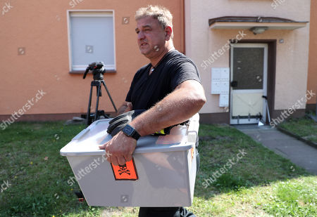 Reptile expert Roland Byner search a house for a escaped cobra snake in Herne, Germany, 26 August 2019. A cobra escaped from Herne in North Rhine-Westphalia. Police suspect the dangerous poisonous snake in the area and have had houses evacuated. The search was carried out with the help of adhesive tape and flour.
