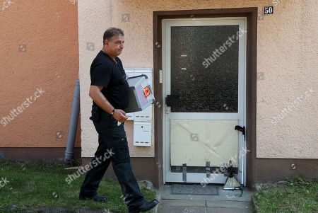 Stock Picture of Reptile expert Roland Byner search a house for a escaped cobra snake in Herne, Germany, 26 August 2019. A cobra escaped from Herne in North Rhine-Westphalia. Police suspect the dangerous poisonous snake in the area and have had houses evacuated. The search was carried out with the help of adhesive tape and flour.