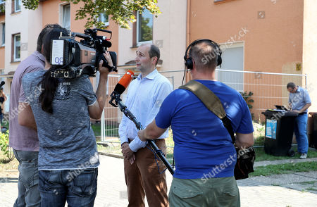 Stock Photo of Christoph Huesken, press speaker of the city Herne gives media an interview to the investigation conditions of the missing Cobra snake in Herne, Germany, 26 August 2019. A cobra escaped from Herne in North Rhine-Westphalia. Police suspect the dangerous poisonous snake in the area and have had houses evacuated. The search was carried out with the help of adhesive tape and flour.