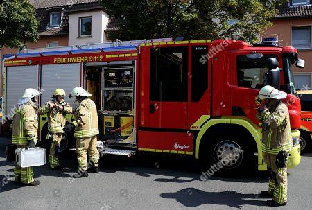Firefighters arrive to search for a missing cobra snake in Herne, Germany, 26 August 2019. A cobra escaped from Herne in North Rhine-Westphalia. Police suspect the dangerous poisonous snake in the area and have had houses evacuated. The search was carried out with the help of adhesive tape and flour.