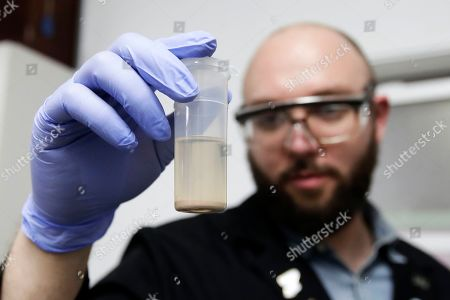 Chemist David Dawson holds up a vial of an extracted cannabis-infused chocolate bar as he demonstrates testing for THC and other chemicals at CW Analytical Laboratories in Oakland, Calif. Chemists are trying to solve a scientific mystery involving marijuana brownies. Chocolate seems to throw off test results for potency. That could be dangerous for consumers looking to relax, not hallucinate