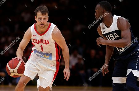 Kevin Pangos, Kemba Walker. Canada's Kevin Pangos, left, drives past the United States' Kemba Walker during their exhibition basketball game in Sydney, Australia