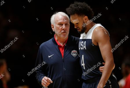 Gregg Popovich, Derrick White. USA's head coach Gregg Popovich, left, talks with player Derrick White during their exhibition basketball game in Sydney, Australia