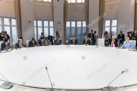 Japan Prime Minister Shino Abe, Antonio Gutteres, South African President Cyril Ramaphosa, Burkina Faso's President Roch Marc Christian Kabore, Rwanda's President Paul Kagame, French President Emmanuel Macron, Egyptian President and Chairman of the African Union Abdel Fattah al-Sissi, Chile's President Sebastian Pinera and German Chancellor Angela Merkel attend a work session focused on climate in Biarritz