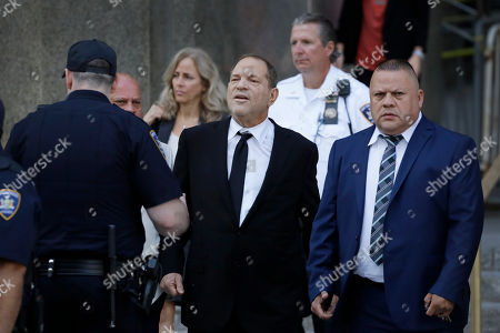Harvey Weinstein, center, leaves court, in New York. Weinstein's lawyers want the trial moved from New York City to Long Island or upstate New York - part of the last-minute wrangling that includes efforts by prosecutors to bolster their case with testimony from actress Annabella Sciorra, who says Weinstein raped her in the 1990s. Weinstein has denied all accusations of non-consensual sex