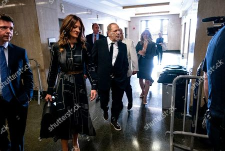 Harvey Weinstein, center, appears in a courthouse for a scheduled arraignment, in New York. Weinstein's lawyers want the trial moved from New York City to Long Island or upstate New York, part of the last-minute wrangling that includes efforts by prosecutors to bolster their case with testimony from actress Annabella Sciorra, who says Weinstein raped her in the 1990s. Weinstein has denied all accusations of non-consensual sex