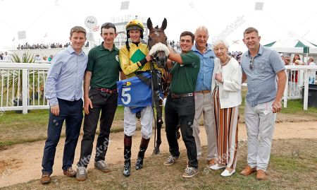 MOLLIANA (Brendan Powell) with trainer Neil Mulholland (left) and owner Mike Burbidge (3rd right) after The Oakbridge Clarendon Handicap Les Landes, Jersey