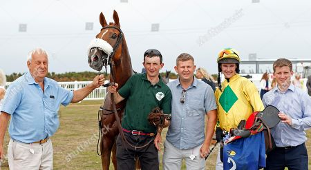 Stock Image of MAN OF THE SEA (Brendan Powell) with trainer Neil Mulholland (right) and owner Mike Burbidge (left) after The Sue & Nigel Pritchard Sprint Handicap Les Landes Jersey