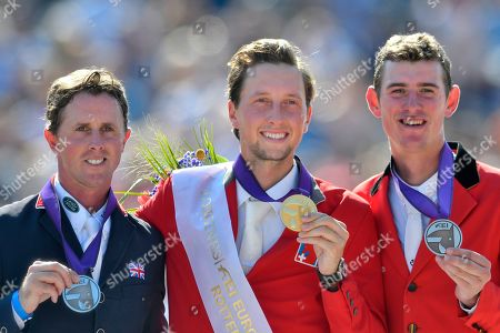 Ben Maher of Great Britain, Martin Fuchs of Switzerland and Jos Verlooy of Belgium