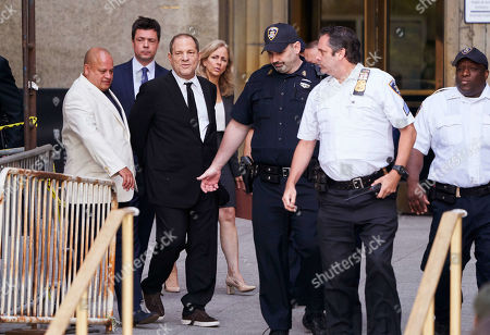 Disgraced movie producer Harvey Weinstein (3-L), leaves New York State Supreme Court following a hearing related to his upcoming trial on charges of rape and sexual assault in New York, New York, USA, 26 August 2019. Weinstein is being re-arraigned on revised charges based on rape accusations from actress Annabella Sciorra and a judge in the case was expected to rule on a motion by defense attorneys to move the case out of New York City.