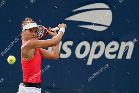 Stock Picture of Viktorija Golubic of Switzerland hits a return to Shuai Zhang of China during their match on the first day of the US Open Tennis Championships the USTA National Tennis Center in Flushing Meadows, New York, USA, 26 August 2019. The US Open runs from 26 August through 08 September.