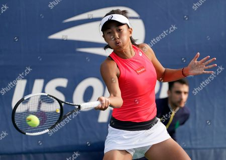 Stock Image of Shuai Zhang of China hits a return to Viktorija Golubic of Switzerland during their match on the first day of the US Open Tennis Championships the USTA National Tennis Center in Flushing Meadows, New York, USA, 26 August 2019. The US Open runs from 26 August through 08 September.