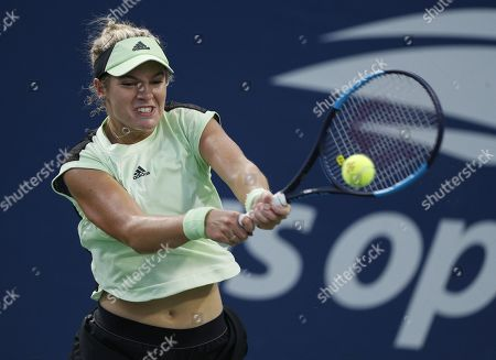 Stock Picture of Catherine McNally of the US hits a return to Timea Bacsinszky of Switzerland on the first day of the US Open Tennis Championships the USTA National Tennis Center in Flushing Meadows, New York, USA, 26 August 2019. The US Open runs from 26 August through 08 September.