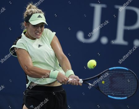Catherine McNally of the US hits a return to Timea Bacsinszky of Switzerland on the first day of the US Open Tennis Championships the USTA National Tennis Center in Flushing Meadows, New York, USA, 26 August 2019. The US Open runs from 26 August through 08 September.