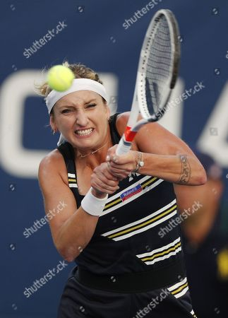Timea Bacsinszky of Switzerland hits a return to Catherine McNally of the US on the first day of the US Open Tennis Championships the USTA National Tennis Center in Flushing Meadows, New York, USA, 26 August 2019. The US Open runs from 26 August through 08 September.