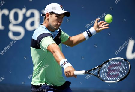 Dusan Lajovic, of Serbia, returns a shot to Steve Darcis, of Belgium, during the first round of the US Open tennis tournament, in New York