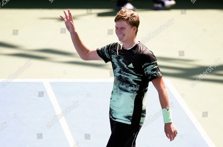 Jenson Brooksby, of the United States, waves to the crowd after beating Tomas Berdych, of the Czech Republic, during the first round of the US Open tennis tournament, in New York