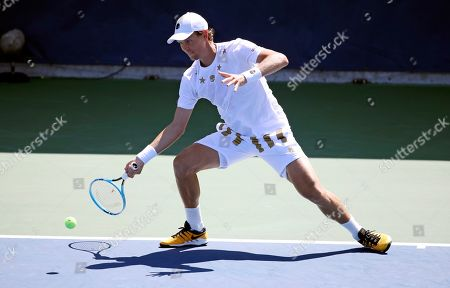 Tomas Berdych, of the Czech Republic, returns a shot to Jenson Brooksby, of the United States, during the first round of the US Open tennis tournament, in New York