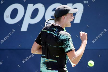 Jenson Brooksby, of the United States, reacts after winning a point against Tomas Berdych, of the Czech Republic, during the first round of the US Open tennis tournament, in New York