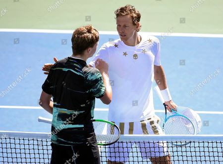 Tomas Berdych, of the Czech Republic, right, congratulates Jenson Brooksby, of the United States, after Brooksby won their first round match of the US Open tennis tournament, in New York